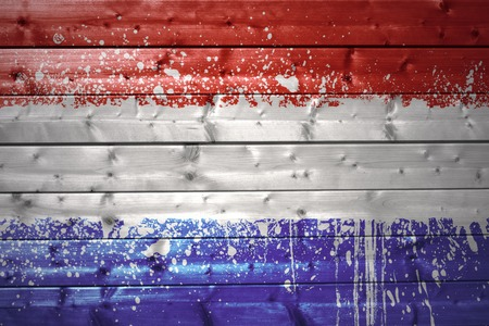 colorful painted dutch flag on a wooden texture photo