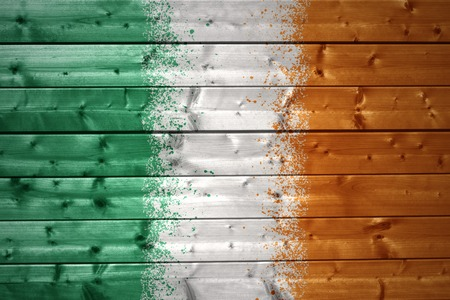 irish flag: colorful painted irish flag on a wooden texture