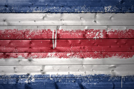 costa rica flag: colorful painted costa rica flag on a wooden texture Stock Photo