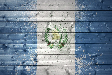 guatemalan: colorful painted guatemalan flag on a wooden texture Stock Photo