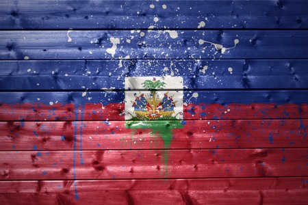haitian: colorful painted haitian flag on a wooden texture
