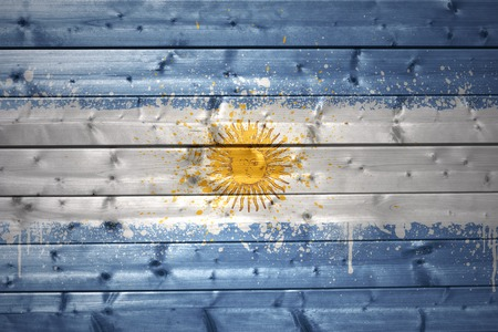 argentinean: colorful painted argentinean flag on a wooden texture