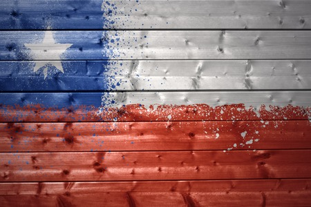chilean flag: colorful painted chilean flag on a wooden texture