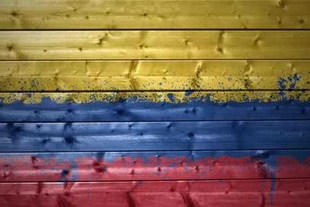 colombian flag: colorful painted colombian flag on a wooden texture Stock Photo