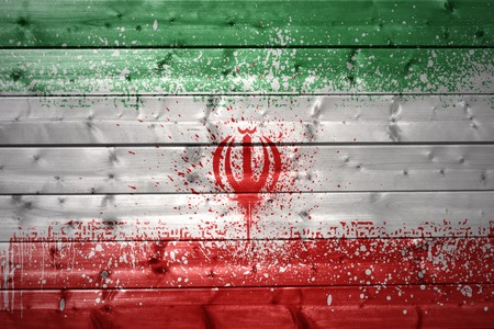 iranian: colorful painted  iranian flag on a wooden texture