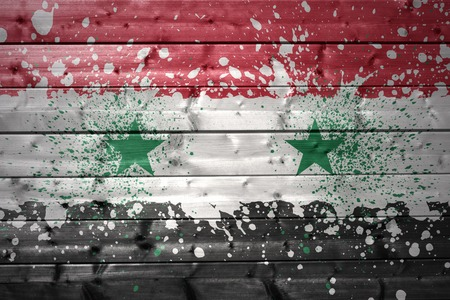 syrian: colorful painted syrian flag on a wooden texture Stock Photo