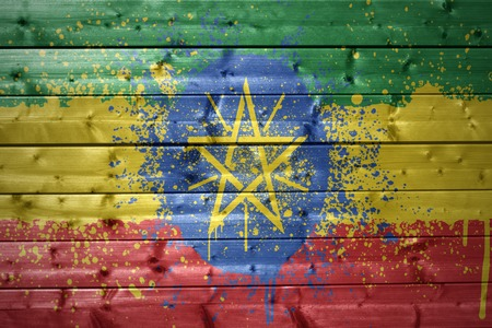 ethiopian: colorful painted ethiopian flag on a wooden texture