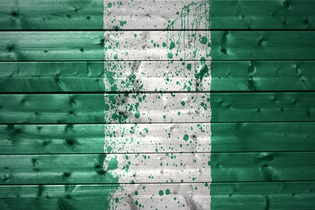 south africa flag: colorful painted nigerian flag on a wooden texture