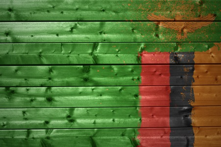 zambian flag: colorful painted zambian flag on a wooden texture