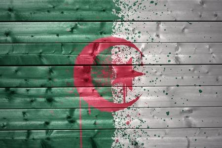 algerian flag: colorful painted algerian flag on a wooden texture