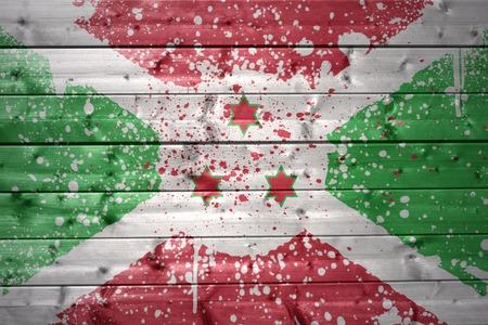 burundi: colorful painted burundi flag on a wooden texture Stock Photo