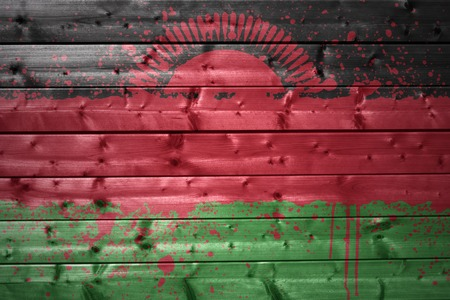 malawi flag: colorful painted malawi flag on a wooden texture