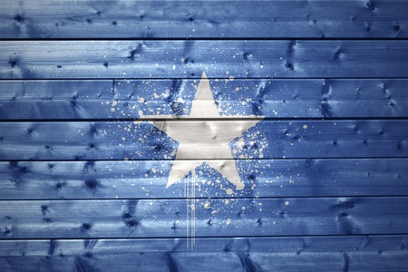 somali: colorful painted somalia flag on a wooden texture