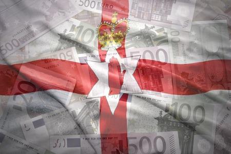 northern ireland: colorful waving northern ireland flag on a euro money background