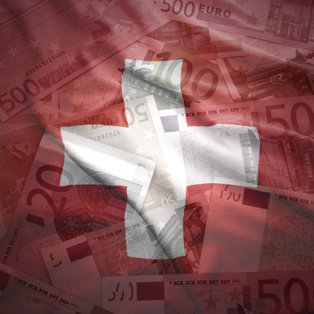 colorful waving swiss flag on a euro money background Stock Photo