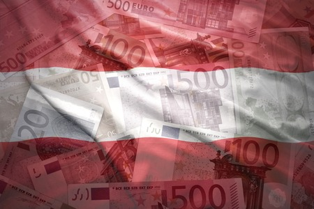 financial stability: colorful waving austrian flag on a euro money background