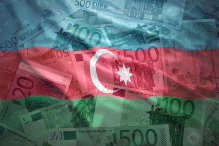 baku: colorful waving azerbaijani flag on a euro money background