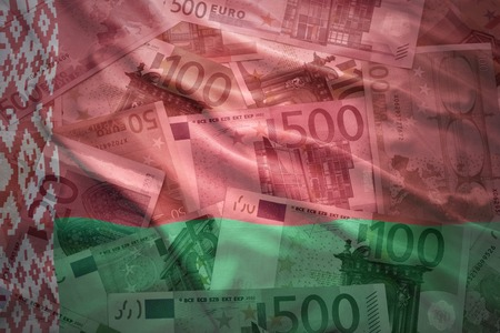european currency: colorful waving belarus flag on a euro money background