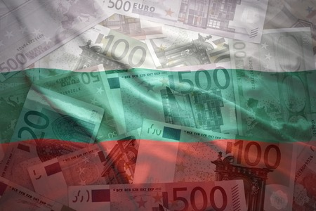 financial stability: colorful waving bulgarian flag on a euro money background