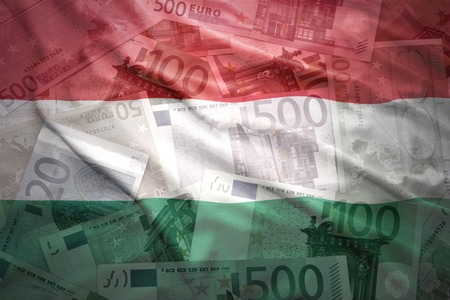 financial stability: colorful waving hungarian flag on a euro money background Stock Photo