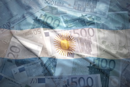argentinean: colorful waving argentinean flag on a euro money background