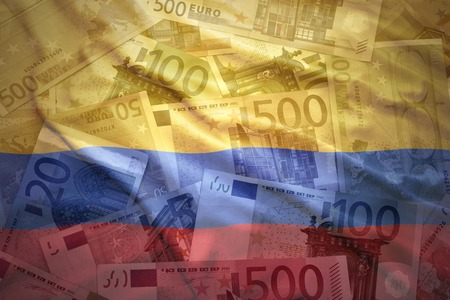 colombian flag: colorful waving colombian flag on a euro money background Stock Photo