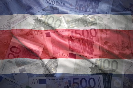 costa rican: colorful waving costa rican flag on a euro money background