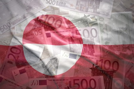 greenlandic: colorful waving greenlandic flag on a euro money background Stock Photo