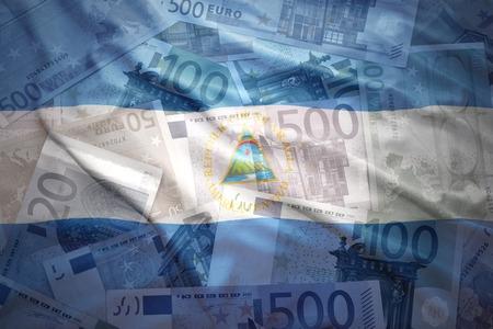 nicaraguan: colorful waving nicaraguan flag on a euro money background