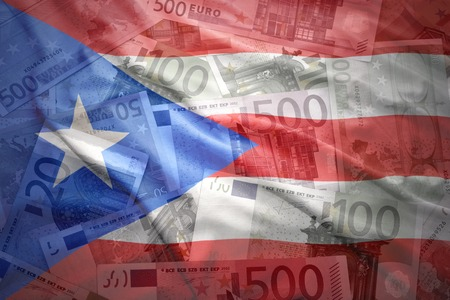 puerto rican: colorful waving puerto rican flag on a euro money background