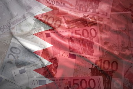middle east crisis: colorful waving bahrain flag on a euro money background Stock Photo