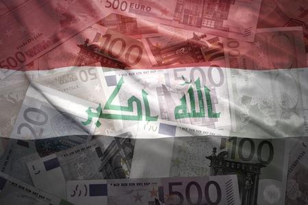 iraqi: colorful waving iraqi flag on a euro money background Stock Photo