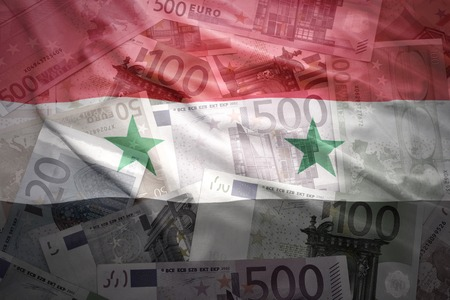 syrian: colorful waving syrian flag on a euro money background