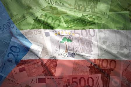 equatorial: colorful waving equatorial guinea flag on a euro money background
