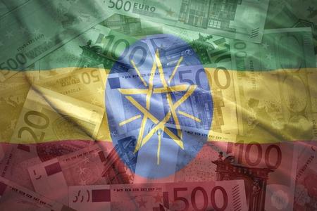 ethiopian: colorful waving ethiopian flag on a euro money background Stock Photo