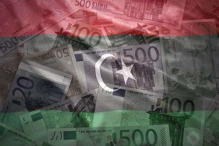 libyan: colorful waving libyan flag on a euro money background Stock Photo