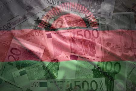 malawi flag: colorful waving malawi flag on a euro money background Stock Photo