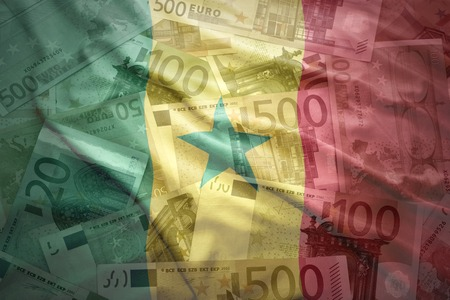 senegalese: colorful waving senegalese flag on a euro money background