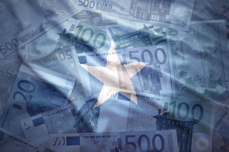 somali: colorful waving somalia flag on a euro money background
