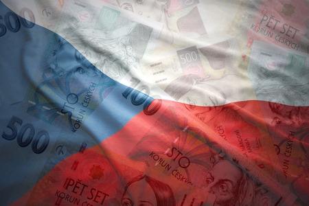 kleurrijke wapperende Tsjechische vlag op een Tsjechische kroon geld achtergrond