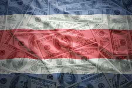 costa rican flag: colorful waving costa rican flag on a american dollar money background