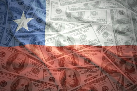 chilean flag: colorful waving chilean flag on a american dollar money background