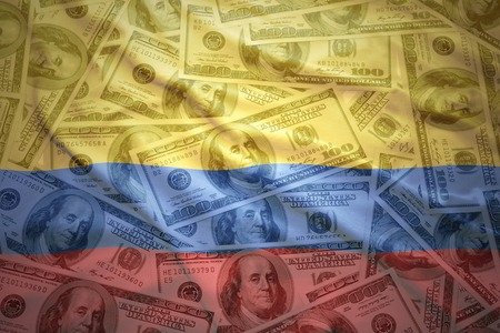 colombian flag: colorful waving colombian flag on a american dollar money background