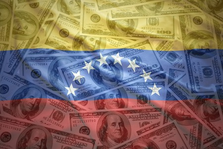 venezuelan: colorful waving venezuelan flag on a american dollar money background Stock Photo