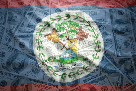 belize: colorful waving belize flag on a american dollar money background