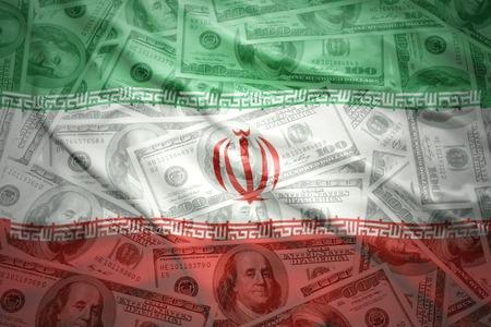 dollar: colorato sventolando bandiera iraniana su uno sfondo di denaro dollaro americano Archivio Fotografico