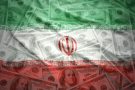 dollar: colorful waving iranian flag on a american dollar money background Stock Photo