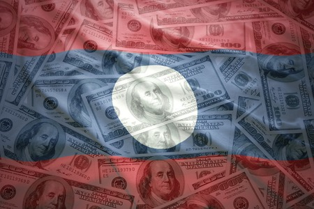 laotian: colorful waving laotian flag on a american dollar money background Stock Photo