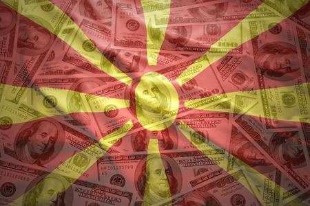 macedonian flag: colorful waving macedonian flag on a american dollar money background