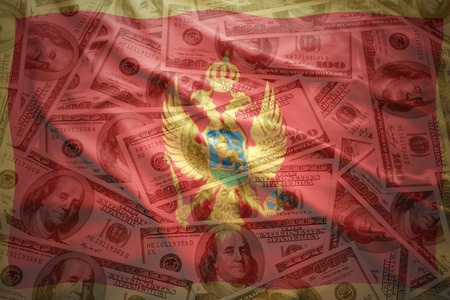 financial stability: colorful waving montenegrin flag on a american dollar money background Stock Photo
